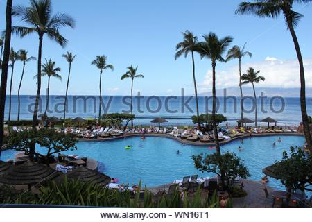 Blue swimming pool under blue sky - Stock Photo