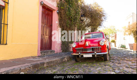 Red automobile on one of the cobblestone streets, in the city of Colonia del Sacramento, Uruguay. It is one of the oldest cities in Uruguay. World Her - Stock Photo