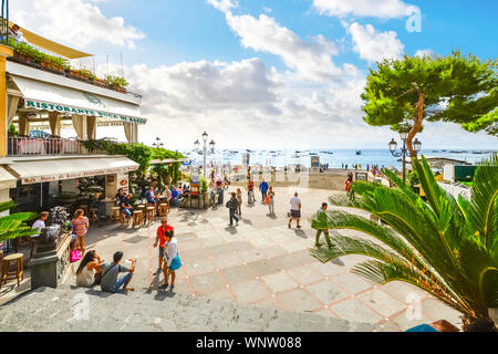 The sandy beach, cafes and shops at the coastal town of Positano Italy on the  Amalfi Coast of the Mediterranean Sea - Stock Photo