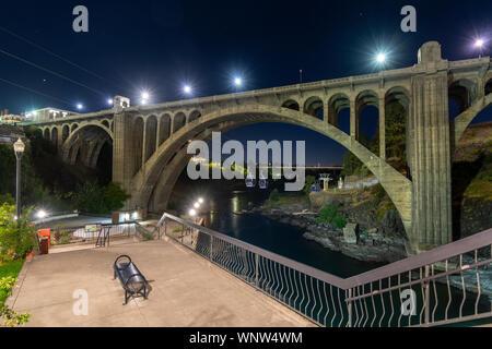 The Monroe Street Bridge over the Spokane River in downtown Riverfront Park area of Spokane, Washington, late at night. - Stock Photo