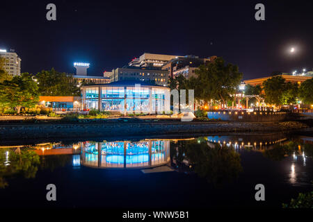 Evening at the illuminated Looff Carousel which runs along the Spokane River at Riverfront Park in Downtown Spokane, Washington - Stock Photo