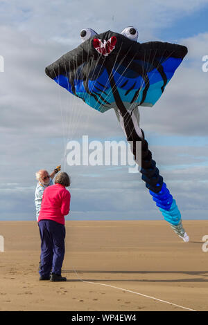 Lytham St Annes on Sea. UK Weather. 7th September 2019.  On a lovely sunny day over the north west coastline, the preparations for the annual Giant Kite Festival are well under way on the beach at Lytham St. Annes in Lancashire.  Credit: Cernan Elias/Alamy Live News - Stock Photo