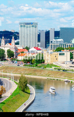 Vilnius, Lithuania - August 19, 2019: View to Vilnius old city, modern downtown and Neris river in Vilnius, Lithuania - Stock Photo