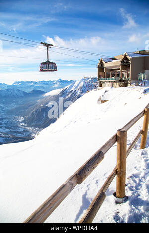 Chamonix, France - January , 28, 2015: Cable Car from Chamonix to the summit of the Aiguille du Midi  and lift station high in the mountains Chamonix, - Stock Photo
