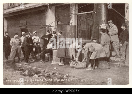 WW1 era postcard issued by Newspaper Illustrations, London, of Scottish highlander soldiers relaxing and socialising at outdoor barber shop, military barber, French, British and Indian soldiers, Verdun, Western Front, France, circa 1916 - Stock Photo