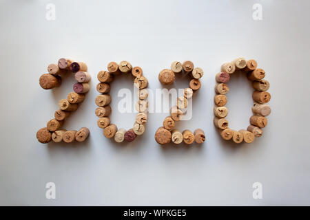 Wine corks 2020 New Year composition isolated on white background - Stock Photo
