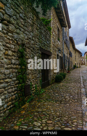 View of an alley in the medieval village Perouges, Ain department, France - Stock Photo