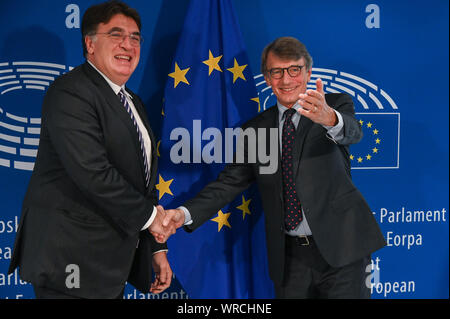 (190910) -- BRUSSELS, Sept. 10, 2019 (Xinhua) -- European Parliament President David Sassoli (R) meets with Theodore Theodoridis, General Secretary of the Union of European Football Associations (UEFA), for a working meeting in Brussels, Belgium, Sept. 10, 2019. (Photo by Riccardo Pareggiani/Xinhua) - Stock Photo