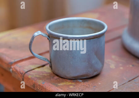 Empty stainless steel cup .Metal Cup, Mug. Realistic Metallic Chrome, Silver Cup Isolated . Old aluminum cup. - Stock Photo