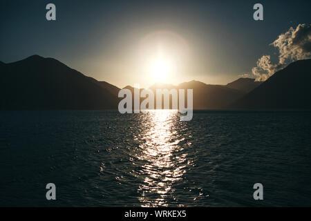 Beautiful sea view of Boko Kotor Bay at sunrise or sunset in Montenegro. Natural mountain landscape. - Stock Photo