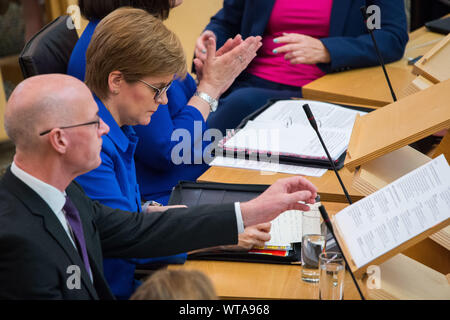 Edinburgh, UK. 5 September 2019. Pictured: (L-R) John Swinney - Depute First Minister; Nicola Sturgeon MSP - First Minister & Leader of the Scottish National Party.  First Ministers Questions in the chamber takes place after the summer break.  Colin Fisher/CDFIMAGES.COM - Stock Photo
