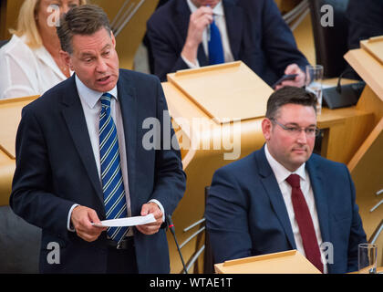 Edinburgh, UK. 5 September 2019. Pictured: (L-R) Murdo Fraser MSP - Shadow Cabinet Secretary for Finance; Miles Briggs MSP - Shadow Cabinet Secretary for Health and Sport. Murdo Fraser is asking about the Scottish Governments proposal about where the return of the Stone of Destiny will finally be at First Ministers Questions.  Colin Fisher/CDFIMAGES.COM - Stock Photo