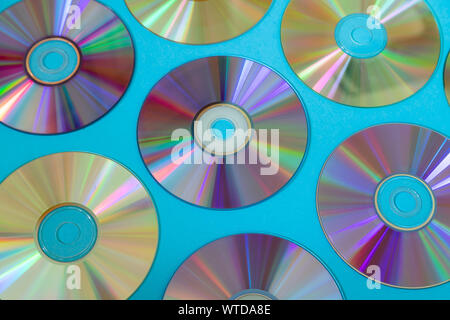 Vintage CD or DVD disk background, old circle discs used for data storage, share movies and music - Stock Photo