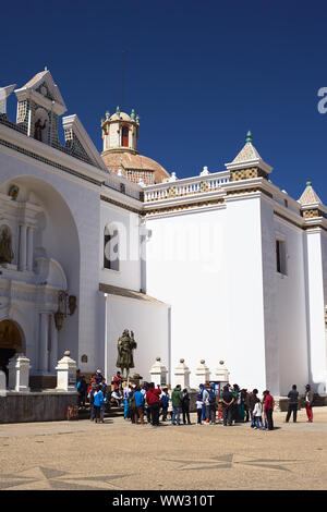 COPACABANA, BOLIVIA - OCTOBER 18, 2014: Unidentified people at the entrance of the Basilica of Our Lady of Copacabana in the small tourist town - Stock Photo