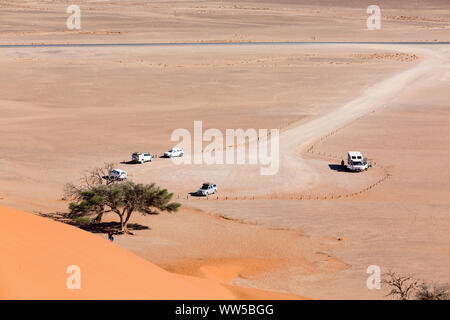Parking area in front of Dune 45 with off-road vehicles, Sossusvlei, Namib Naukluft Park, Namibia - Stock Photo