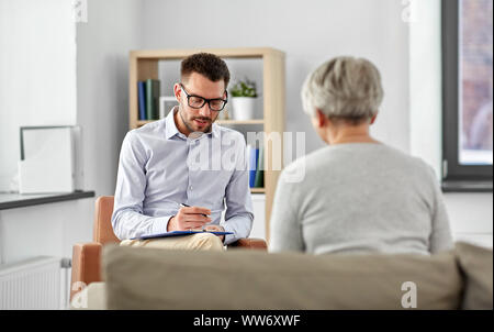 senior woman patient and psychologist - Stock Photo