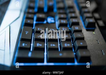 Gamer keyboard with colorful blue lights, modern gamer computer. Blue backlight, backlit on laptop or keyborad computer of gaming. - Stock Photo
