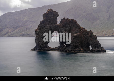 Roque de la Bonanza, volcanic rock formation, long exposure photography, Valverde, El Hierro island, Canary Islands, Spain - Stock Photo