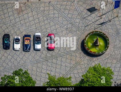 Aerial view, vintage convertibles at Petrusbrunnen, car rally, vintage Porsche and Mercedes convertible, Kump, Brilon, Sauerland, North Rhine-Westphal - Stock Photo