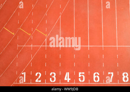 Start and Finish point of race track or athletics track start line with lane numbers Top view Drone shot high angle view. - Stock Photo