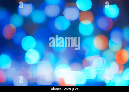 Abstract blue bokeh lights background. Blurred colored lights garlands. Beautiful Christmas and New Year background - Stock Photo