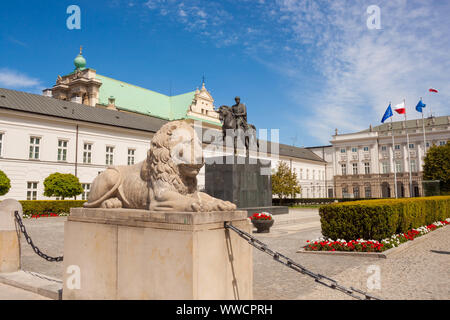 Warsaw, Poland - May 5, 2018: Sculpture of lion (1821) and equestrian statue of Prince Jozef Antoni Poniatowski in front of Presidential palace - Stock Photo