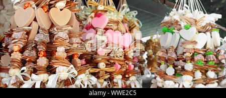 Hand made natural herbal soaps on a rope on the market. Banner - Stock Photo