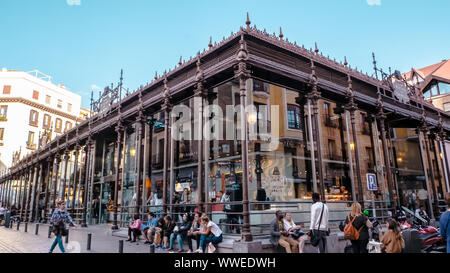 Madrid / Spain - 04 14 2019: Famous Spanish tapas place Mercado de San Miguel is a covered market in Madrid, Spain located in the downtown area. - Stock Photo