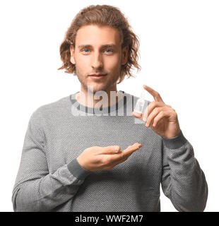 Young man with nasal drops on white background - Stock Photo