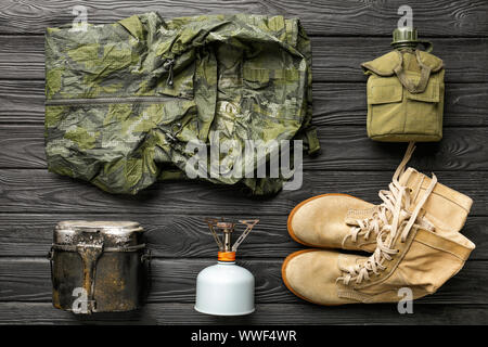 Set of items for camping on wooden background - Stock Photo
