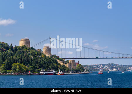 Istanbul Bosphorus and Rumelihisari Fortress landscape view from the sea in sunny day - Stock Photo