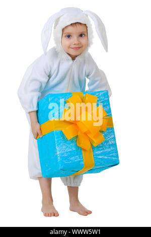 A child dressed as a rabbit with a gift in a box isolated on white background - Stock Photo