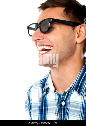 Side view of handsome smiling caucasian guy, closeup shot - Stock Photo