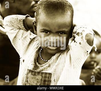AFRICA,KENYA,SAMBURU,NOVEMBER 8:portrait of an African Kid of Samburu tribe village posing to camera,review of daily life of local people,near Samburu - Stock Photo