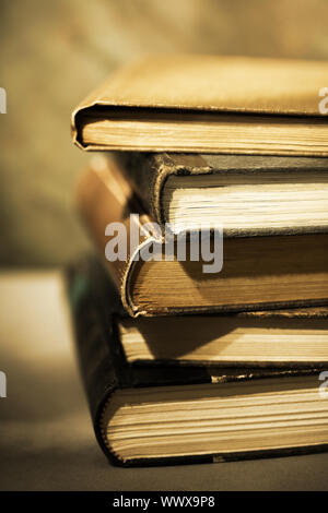 Sepia toned image of stacked books. - Stock Photo