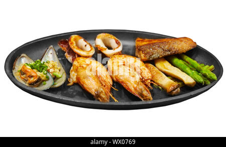 Seafood steak with prawns mussels and salmon isolated on white background - Stock Photo