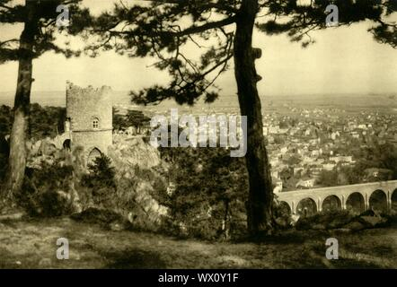 """The Black Tower, Mödling, Lower Austria, c1935. View of the town from the 19th century Schwarzer Turm, a three-storey tower built in the early 19th century on the foundations of an older guard house. From """"Österreich - Land Und Volk"""", (Austria, Land and People). [R. Lechner (Wilhelm Müller), Vienna, c1935] - Stock Photo"""