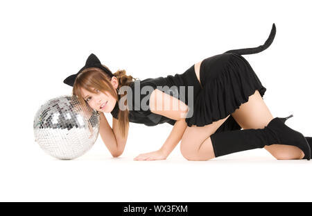 picture of girl in cat costume playing with disco ball - Stock Photo