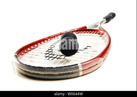 Close up of a squash racket and balls on white - Stock Photo