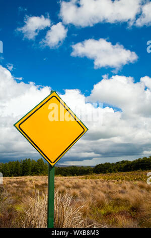 Blank yellow road sign against cloudy sky - Stock Photo