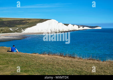 View over Cuckmere Haven from Seaford Head, near Eastbourne, East Sussex, looking east towards Seven Sisters cliffs - Stock Photo