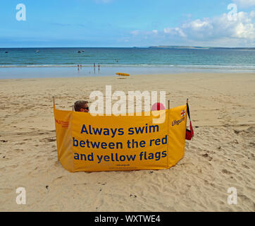 A quiet day off season at St Ives, but the Lifeguards are on duty to keep us safe - Stock Photo