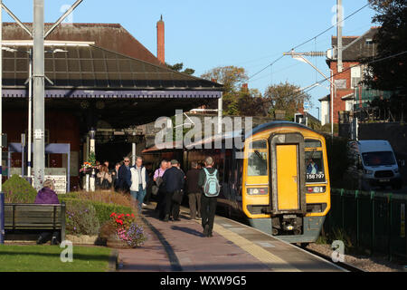 Class 158 Northern liveried express sprinter diesel multiple unit train at a platform in Poulton-le-Fylde railway station on 17th September 2019. - Stock Photo