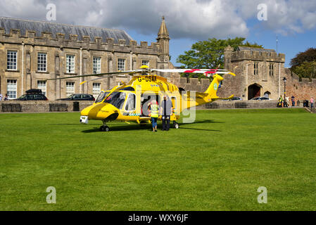 Helicopter getting ready for take off after the end of services day - Stock Photo