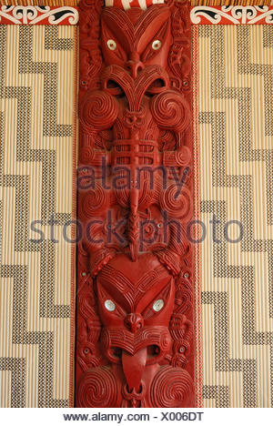 Maori carving, wooden relief with mother of pearl inlays, figural representation and ornaments, Maori Meeting House - Stock Photo