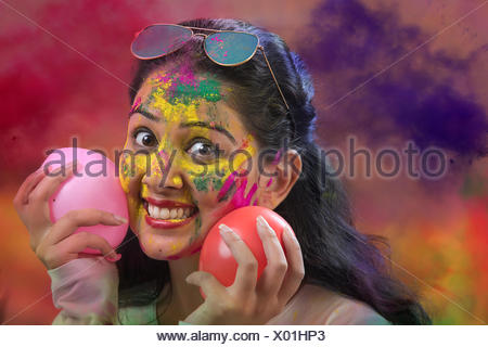 Indian Happy Young Girl With Holi Balloons at Holi Festival - Stock Photo