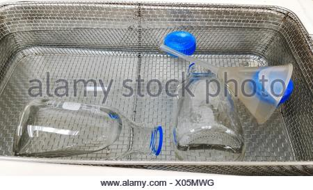 High Angle View Of Flasks And Funnel In Water At Laboratory - Stock Photo