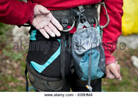 Italy, Midsection of female rock climber - Stock Photo