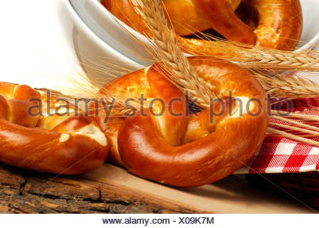 Lye pretzels and wheat spikes - Stock Photo