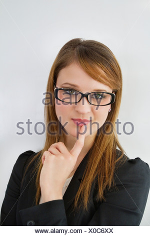 Portrait of beautiful businesswoman wearing eyeglasses - Stock Photo